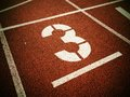 Number Three. White Track Number On Red Rubber Racetrack, Royalty Free Stock Photos - 77877468