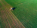 Tractor Mowing Green Field Stock Images - 77896194