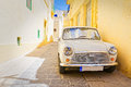 Car Parked In An Alley In Ir-Rabat, Gozo Royalty Free Stock Photo - 77899835