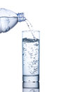 Drinking Water Is Poured Into A Glass From Bottle Stock Image - 77908931