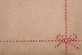 Christmas String Or Twine Tied In A Bow On Kraft Paper Backdrop Stock Photos - 77916113