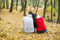 Beautiful Couple In Autumn Park Sitting On The Ground Royalty Free Stock Photos - 77926078