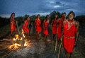 Warriors The Masai Tribe Dancing Ritual Dance Around The Fire Late In The Evening. Stock Image - 77931731