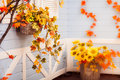 Basket With Flowers And Autumn Leaves Hanging On The Blue Wall O Royalty Free Stock Photos - 77932618