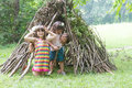 Kids Playing Next To Wooden Stick House Looking Like Indian Hut, Stock Photos - 77947013