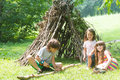 Kids Playing Next To Wooden Stick House Looking Like Indian Hut, Royalty Free Stock Photography - 77947027