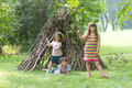 Kids Playing Next To Wooden Stick House Looking Like Indian Hut, Stock Image - 77947041