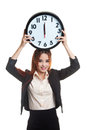 Young Asian Business Woman With A Clock. Stock Image - 77961181