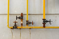 System Of The Old Gas Control Valves And Gas Pipes On The Wall Stock Photo - 77969940