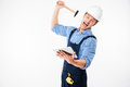Portrait Of A Screaming Builder Trying To Break Pc Tablet Royalty Free Stock Photo - 77976415