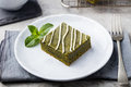 Matcha Green Tea Brownie Dessert With White Chocolate On A White Plate Grey Stone Background Royalty Free Stock Photos - 77982988