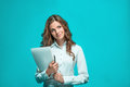 The Smiling Young Business Woman With Pen And Tablet For Notes On Blue Background Stock Photo - 78008030