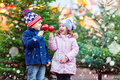 Two Little Kids Eating Sugar Apple On Christmas Market Royalty Free Stock Photos - 78011328