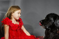 Beauty And The Beast. Girl With Big Black Water-dog. Stock Photography - 78039742