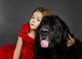 Beauty And The Beast. Girl With Big Black Water-dog. Royalty Free Stock Images - 78039759