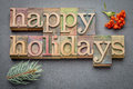 Happy Holidays In Wood Type Royalty Free Stock Photography - 78043627