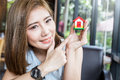 Happy Asian Girl Point To House Model Royalty Free Stock Image - 78047776