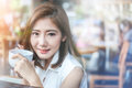 Portrait Of Asian Woman Smiling And Holding Cup Of Coffee Stock Images - 78048134