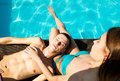 Couple Has A Rest In The Pool With Champagne. They Are Smiling, Hugging And Kissing. Stock Image - 78048841