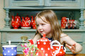 Cute Little Girl Preparing Tea In Teapot Royalty Free Stock Photography - 78073207