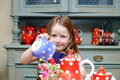 Cute Little Girl Preparing Tea In Teapot Stock Photos - 78073303