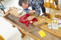 Craftsman Working At Workshop With A Guitar Royalty Free Stock Images - 78079509