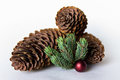 Three Pine Cones With Red Ball Stock Photo - 78092150