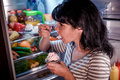 Woman Eating Unhealthy Food From The Fridge At Night Stock Photos - 78150943