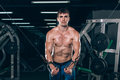 Handsome Bodybuilder Works Out Pushing Up Excercise In Gym Stock Photo - 78164610