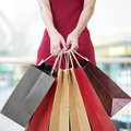 Young Woman Carrying Paper Shopping Bags In Modern Mall Stock Photo - 78180420
