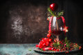 Glass Of Red Wine On Rustic Table With Festive Christmas Decoration And Rosemary At Dark Wooden Background Royalty Free Stock Photography - 78181437