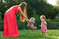 Young Mother In Dress Takes Bear Little Daughter In Park Royalty Free Stock Photo - 78203045