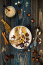Healthy Fall And Winter Breakfast Bowl. Chai Tea Infused Overnight Oats Porridge Topped With Caramelized Bananas, Raw Dark Chocola Stock Image - 78204391
