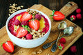 Healthy Breakfast. Mango Maca Smoothie Bowl Topped With Hazelnuts, Oat Granola, Fresh Berries And Raspberry Puree. Stock Photos - 78204573