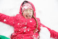 Playful Girl With Braids Playing In The First Snow Royalty Free Stock Photos - 78209668