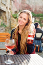 Woman Enjoying Wine In Outdoor Restaurant. Portrait Of A Beautiful Wine Tasting Tourist Girl. Stock Photography - 78210442