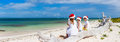 Family At Beach On Christmas Royalty Free Stock Images - 78225789