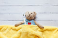 Children S Soft Toy Teddy Bear In Bed With Thermometer And Pills, Take The Temperature Of A Mercury Glass . On  White Stock Image - 78234531