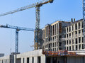 Concrete Building Construction Site With Cranes In Blue Sky Royalty Free Stock Photos - 78259728