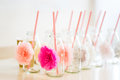 Close Up Of Glass Bottles For Drinks With Straws Royalty Free Stock Images - 78260649