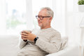 Happy Senior Man With Cup Of Tea At Home Stock Images - 78260934