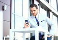 Man On Smartphone - Young Business Man Talking On Smart Phone. Casual Urban Professional Businessman Using Mobile Cell Stock Photography - 78261612