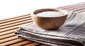 Mineral Bath Salt In Wooden Cup Set On Cotton Towel Royalty Free Stock Photography - 78264007