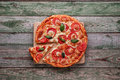 Slice Of Pizza On Wood Chopping Board. Top View Royalty Free Stock Image - 78282846