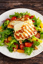 Grilled Halloumi Cheese Salad Witch Orange, Tomatoes And Lettuce. Healthy Food Stock Photography - 78307672