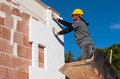 Worker Mounts Sheets Of Polystyrene Stock Photography - 78319832