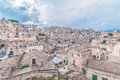 Typical View Of Stones (Sassi Di Matera)  Of Matera Under Blue Sky. Matera In Italy Royalty Free Stock Image - 78327636
