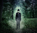 Evil Tall Man Standing In Scary Woods Alone Stock Photos - 78340513