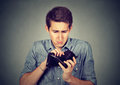 Man With No Money Holding Empty Wallet Stock Photography - 78341562