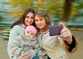 Mother, Daughter And Granddaughter Selfie Royalty Free Stock Image - 78350546